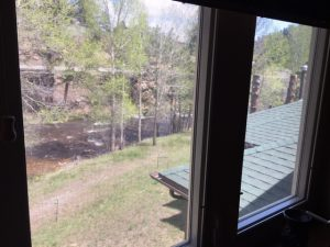 Windows open out to the River